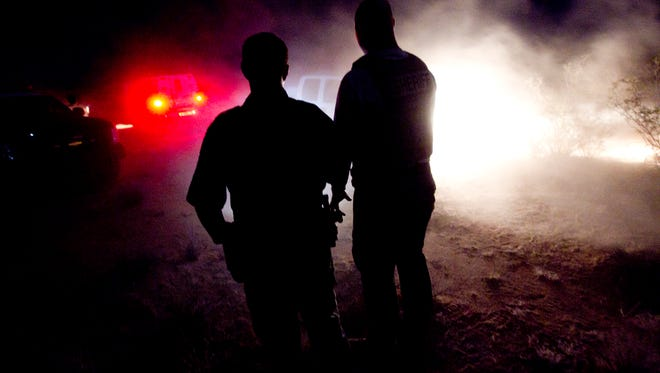Pinal County Sheriff's Office deputries, ICE and Border Patrol agentt on an operation targeting drug and human trafficking activity outside Arizona City in 2010.