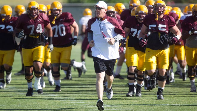 ASU assistant head coach/ offensive line Chris Thomsen (center) during Spring practice at the Kajikawa practice fields at ASU  in Tempe on Thursday, April 3, 2014.