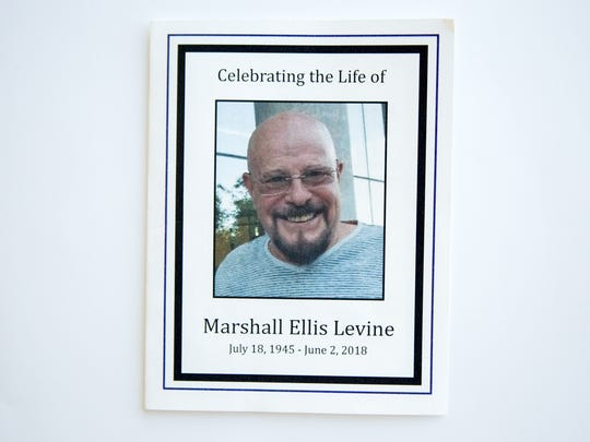 A view of the funeral program for Marshall Ellis Levine, who was found dead in his office at a Scottsdale mental health counseling facility. Levine is one of six murder victims of a Scottsdale serial killer.
