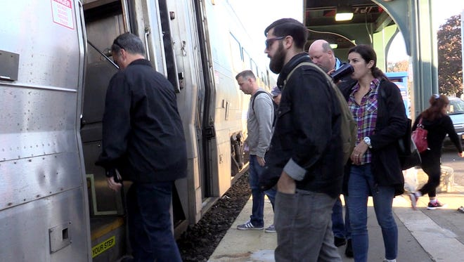 Commuters board an NJ Transit train in Pearl River Oct. 7, 2016. The Pascack Valley Line remains on a weekend schedule after last week's crash at the Hoboken train station.