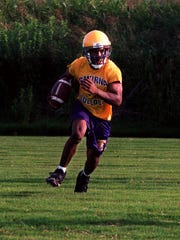 Smyrna quarterback Luke Powell is shown during a 1998 practice.