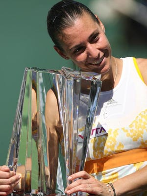 Flavia Pennetta of Italy receives the trophy after defeating Agnieszka Radwanska on Sunday.