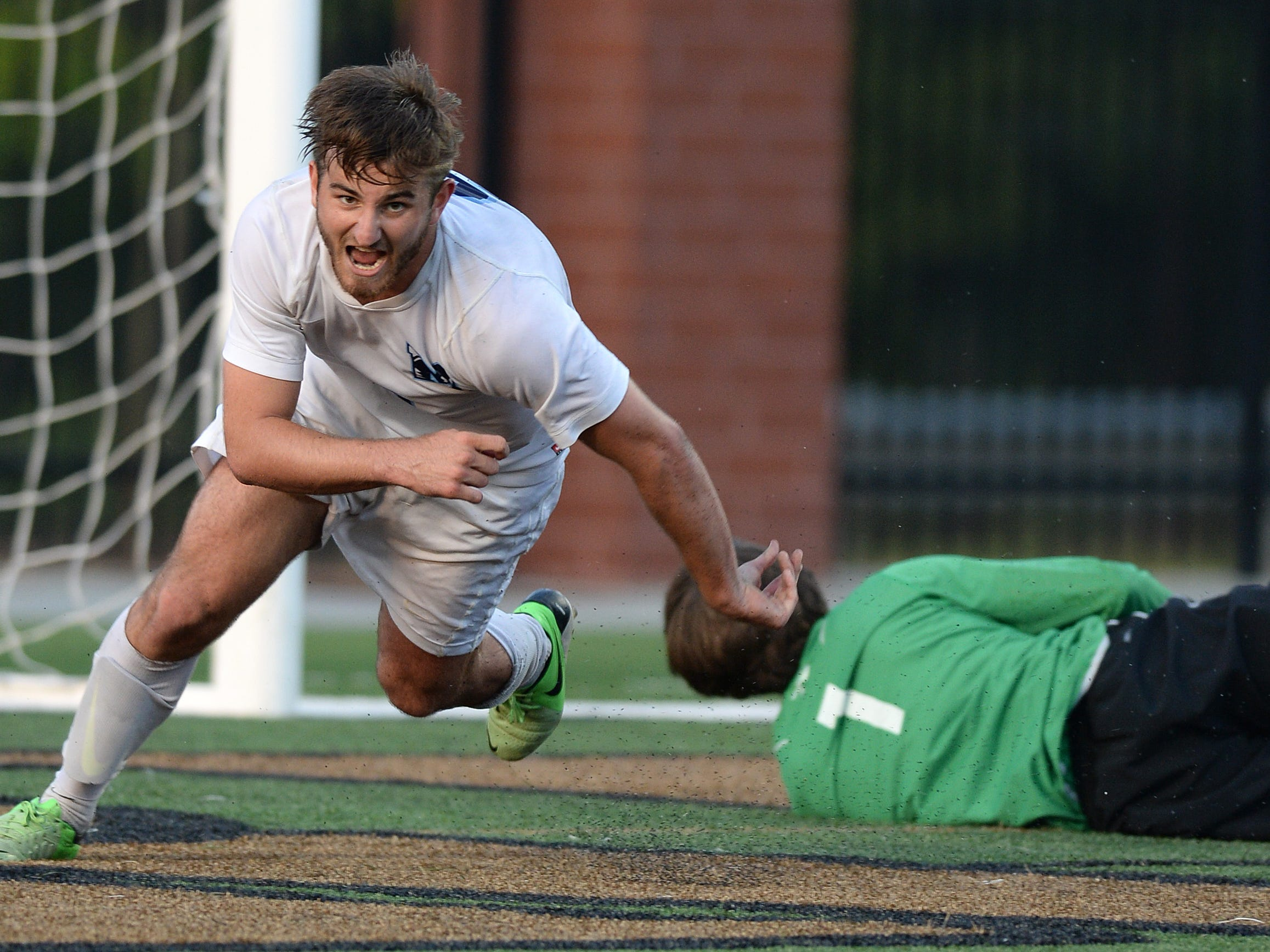 J.L. Mann's Michele Bottari (9) reacts after scoring against Wando in the boys AAAA State Championship game Saturday, May 16, 2015 at River Bluff High in Lexington.