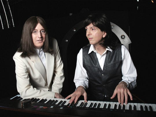 Jim Owen and Tony Kishman, as Lennon and McCartney,  rehearse in their 'Abbey Road' costumes.