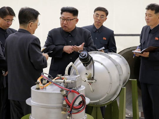This undated file photo distributed by the North Korean government shows North Korean leader Kim Jong Un, center, at an undisclosed location in North Korea. The world is wondering if North Korea's next nuclear test will involve a nuclear missile screaming over Japan after the North said it may test a hydrogen bomb in the Pacific Ocean. Independent journalists were not given access to cover the event depicted in this image distributed by the Korean Central News Agency via Korea News Service. The content of this image is as provided and cannot be independently verified. (Korean Central News Agency/Korea News Service via AP, File)