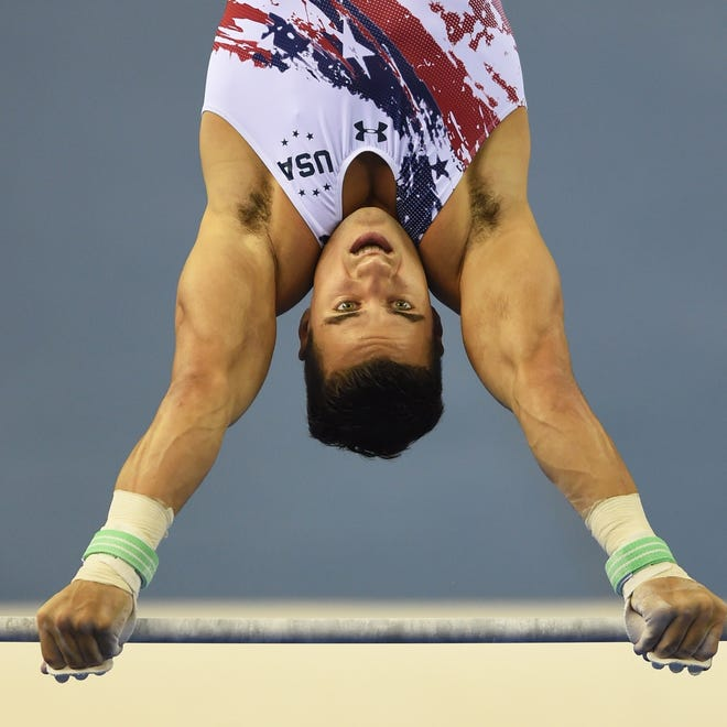 The United States' Jake Dalton, a Spanish Springs grad and 2012 Olympian, performs on the horizontal bar during the men's team final at the Gymnastics World Championships in Nanning, China, on Tuesday.