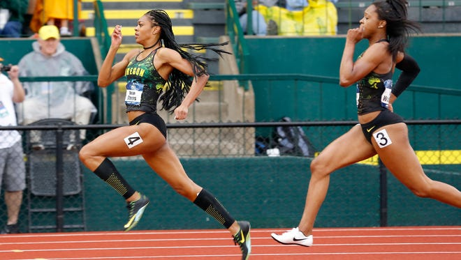 Oregon's Deajah Stevens, left, leads Oregon's Ariana Washington during a semifinal in the women's 200 meters at the NCAA outdoor track and field championships in Eugene, Ore., Thursday, June 9, 2016. (AP Photo/Ryan Kang)