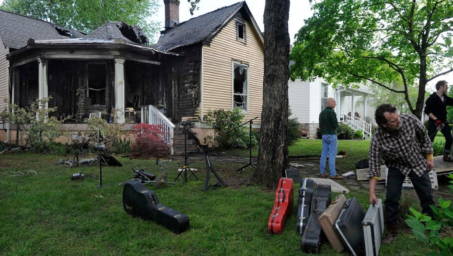 Songwriter Mark Stephen Jones gathers some of the guitars he salvaged at a fire at 4408 Nevada Ave., where he rented a room. No one was injured in the fire on Wednesday, April 22, 2015, in Nashville.