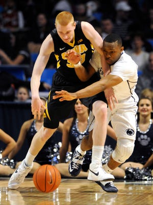 Penn State's Devin Foster tries to steal the ball from Iowa's Aaron White during their NCAA college basketball game at Bryce Jordan Center in State College, Pa., on Saturday, Feb. 28, 2015.