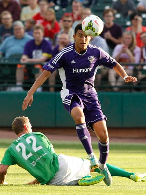 Louisville FC's Tarek Morad (6) battles pressure from OKC Energy FC's Kyle Greig (22) during their game at Louisville Slugger Field in Louisville, Kentucky.         June 27, 2015