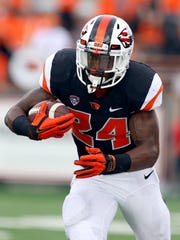 Oregon State senior running back Storm Barrs-Woods is the fifth-leading rusher in school history.
