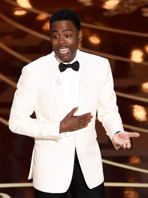 Host Chris Rock delivers an #OscarsSoWhite-themed opening monologue at the Oscars on Sunday, Feb. 28, 2016, at the Dolby Theatre in Los Angeles. (Photo by Chris Pizzello/Invision/AP) ORG XMIT: CACJ357