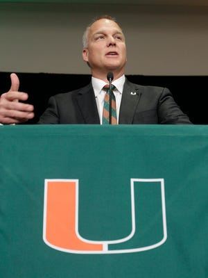 Mark Richt gestures after being introduced as the new NCAA college football head coach at the University of Miami.