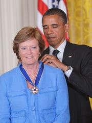 President Barack Obama presents the Presidential Medal of Freedom to Summitt on May 29, 2012 in the East Room of the White House.