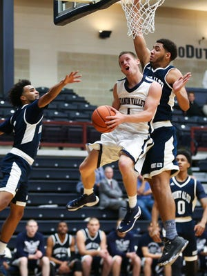 Sam Light, of Lebanon Valley College, goes up for a shot during their 85-70 win over Penn State Mont Alto in the Rinso Marquette Tournament at LVC, Annville, on Saturday.