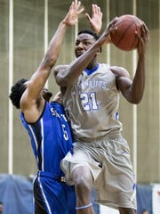 Darryl Tucker (21) takes it to the hoop during the men's basketball game against Shorter University at the University of West Florida on Saturday, February 25, 2017.