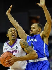 University of Evansville's Ryan Taylor (0) drives against Indiana State's Brenton Scott (4) as the University's of Evansville Purple Aces play the Indiana State Sycamores at the Ford Center Wednesday, January 17, 2018.