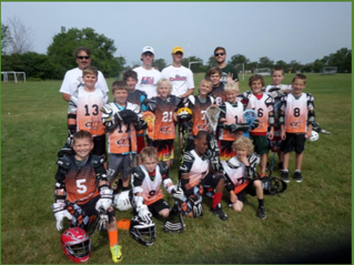 Ben Stover (yellow hat, back row) enjoys coaching a youth box lacrosse team at Heritage Park.
