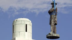 A statue of Confederate General Robert E. Lee is removed