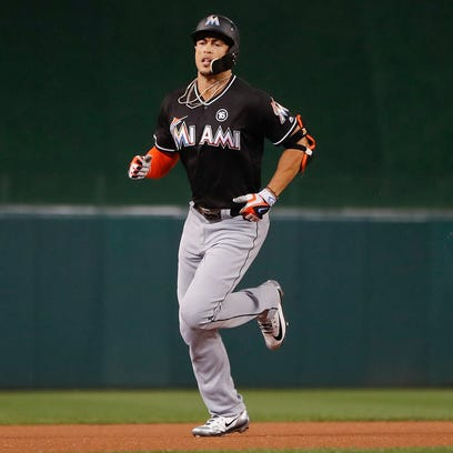 Done deal: Giancarlo Stanton becomes a Yankee