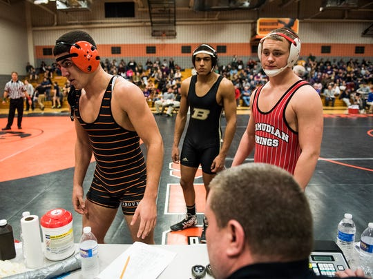 Hanover's Justin Barnes, Biglerville's Michael Southerly and Bermudian Springs' Noah Fleshman await to check in with officials Saturday Feb. 20, 2016 during the Section I AA wrestling at Susquenita High School.