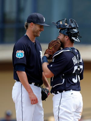 Detroit Tigers starting pitcher Shane Greene, left, smiles as he talks with catcher Bryan Holaday on March 8, 2016.