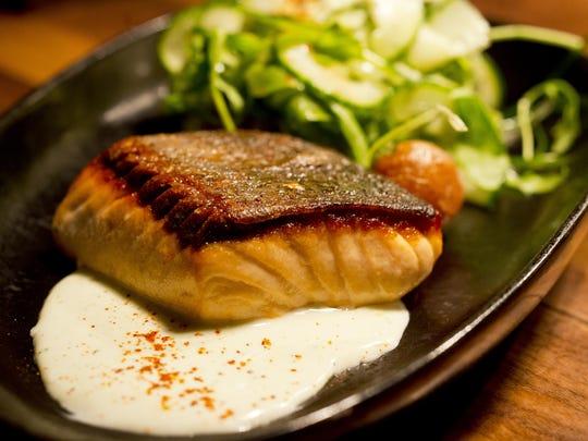 Waterworks Food and Drink in Winooski pan roasted Atlantic salmon with cucumber yogurt, dill and guajillo.