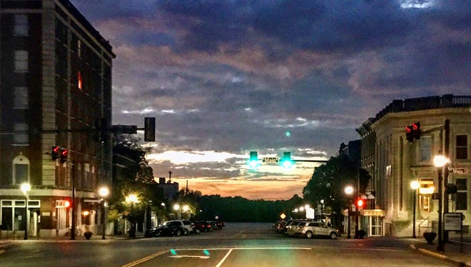"""Local resident Leanne Banna-Pritchett acted fast and captured a cool image of Downtown Henderson last Friday night, Oct. 20. """"Literally taken through the windshield -- had to act fast as it was changing so quickly."""""""