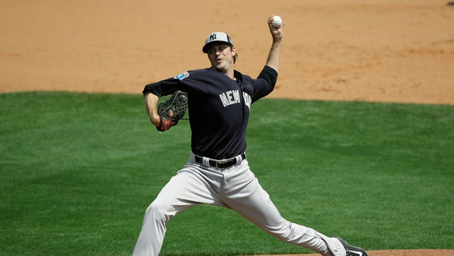 New York Yankees pitcher Andrew Miller pitches against the Atlanta Braves in a spring training baseball game, Wednesday, March 30, 2016, in Kissimmee, Fla.  He his hit by a batted ball on the pitch.