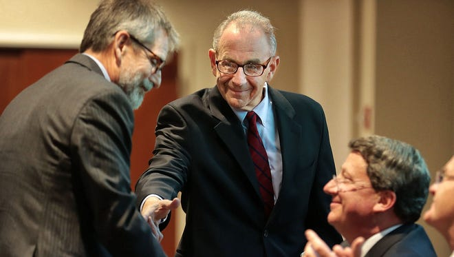 UT College of Medicine Executive Dean David Stern (center) introduces the Director of the Center for Addiction Science Daniel Sumrok (left) during a ceremony at the Halloran Center recognizing the Center for Addiction Science as the first Center of Excellence in Addiction Medicine in the country.