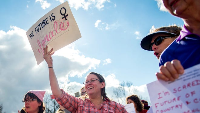 "Meagan Dennison holds up a sign that reads ""The Future is Female"" during the University of Tennessee's ""sister march"" to the Women's March on Washington on Friday, January 20, 2017."