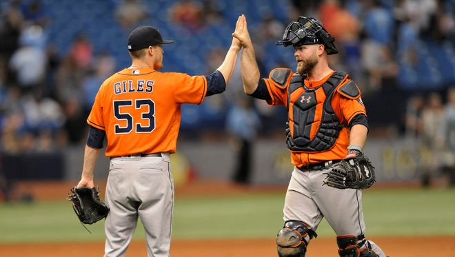 Houston Astros reliever Ken Giles (53) and catcher Brian McCann celebrate a 6-4 win over the Tampa Bay Rays during the 10th inning of a baseball game, Sunday.