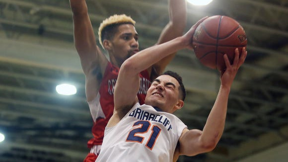 Briarcliff's Anthony Panarese  (21) drives to the basket