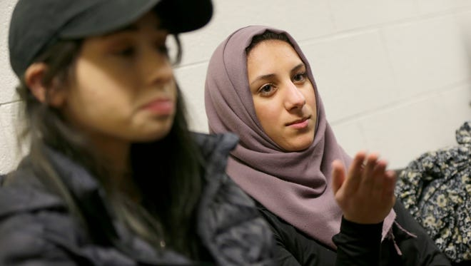 University of Wisconsin-Milwaukee junior Amal Ali (right), of Milwaukee, and freshman Adeel Masalkhi, of West Allis, discuss President Donald Trump''s travel ban at the UWM Student Union on Monday.