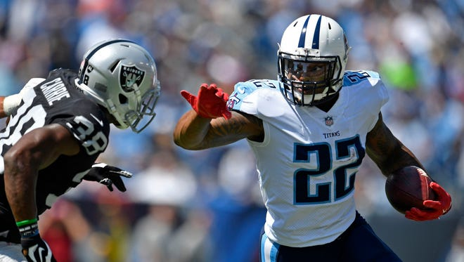 Tennessee Titans running back Derrick Henry (22) runs against Oakland Raiders strong safety T.J. Carrie (38) in the first half at Nissan Stadium Sunday, Sept. 10, 2017 in Nashville, Tenn.