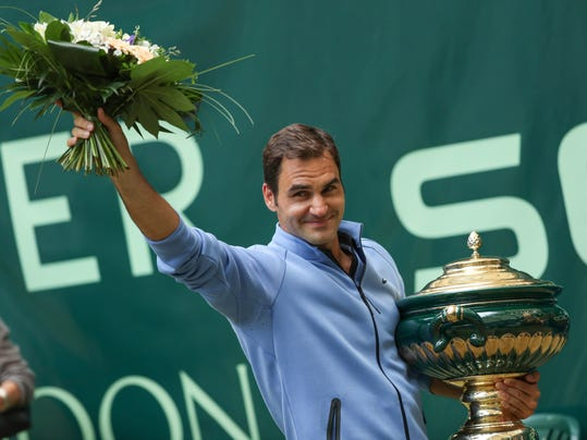 Switzerland's  Roger Federer celebrates his victory after the final match against  Germany's Alexander Zverev at the Gerry Weber Open tennis tournament in Halle, Germany, Sunday, June 25, 2017.  Roger Federer defeated Germany's Alexander Zverev in two sets to win the Gerry Weber Open for the ninth time on Sunday. 