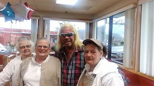 """Duane """"Dog"""" Chapman of A&E's """"Dog the Bounty Hunter"""" surprised employees with a visit to Maple Donuts in Newberry Township on Monday."""