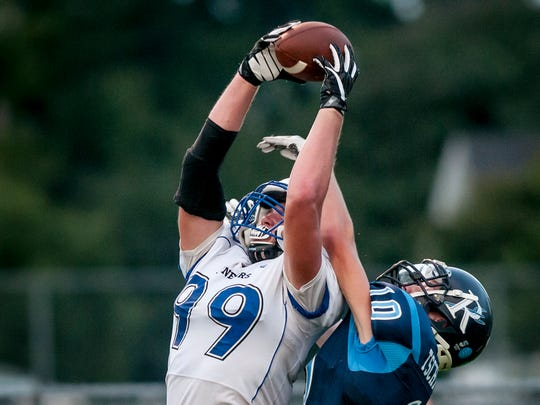 Cros-Lex's Luke Wilson leaps to haul in a pass for a touchdown over Richmond's Kyle Tschiggfrey during a football game Friday, September 9, 2016 at Richmond High School.