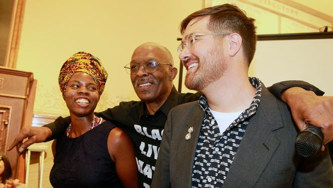 Prentice McKinney (center), an original Commando who took part in the open housing marches in Milwaukee in 1967-'68, joins with Kantara Souffrant (left) and Adam Carr at an event marking the 50th anniversary of the open housing marches at City Hall on Aug. 28, 2017.