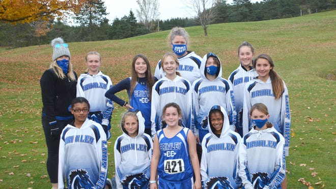 Brimley captured the Eastern UP Conference girls middle school cross country team championship. The Bays include, front row, from left: Angel Barnes-Parish, Lily Carrick, Katie Keyser, Ava Elliott and Addison Hill; back row, from left: assistant coach Jenna Caraccio, Scarlett Garvon, Sixta Smart, Marissa Campeau, coach Joyel Hyvarinen, Sydney Caraccio, Hazel Garvon and Addison Carrick.