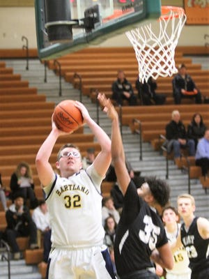 Hartland's Will McCoy (32) scored 18 points in a 50-44 victory over South Lyon East in a Class A district basketball semifinal on Wednesday, March 7, 2018.
