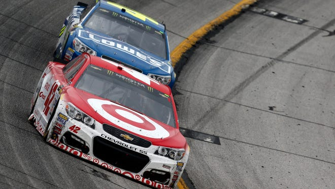 Kyle Larson, front, leads the Cup Series standings through four races. Seven-time and reigning series champion Jimmie Johnson (48) ranks 16th.