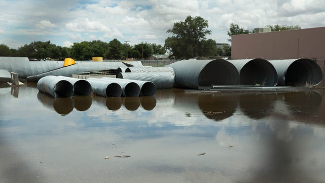 Water floods the yard of the New Mexico Department of Transportation District No 1 Hatch Maintenance Patrol yard Monday July 24,2017, after heavy rains the night before.