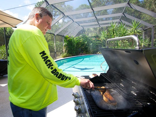 Tom Gates of West Melbourne created and sells Mack Daddy's Blackener, which he's using here to cook steaks on the grill. The blackener is a heavy-duty cast-iron skillet that can be used on the grill or stove or in the oven.