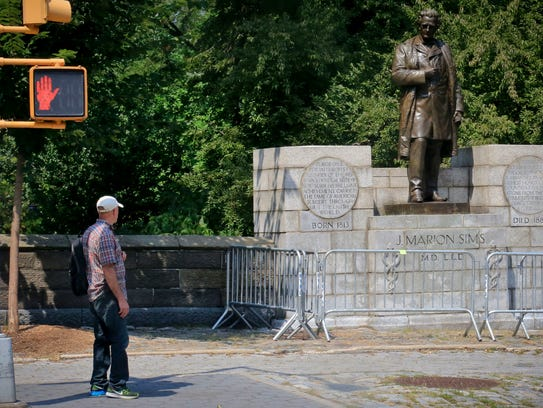 A man looks at a statue in New York's Central Park