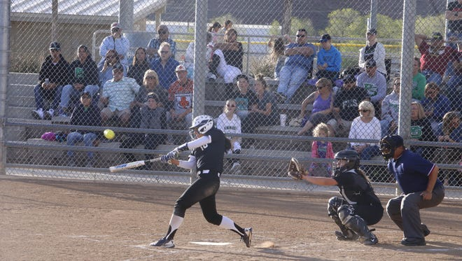 Piedra Vista's Alyssa Herrod hits an RBI double in the first inning against Farmington on Tuesday at the Farmington Sports Complex.