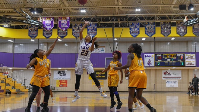 LSUS guard Christina Devers goes up for two of her 32 points against Xavier Saturday afternoon.
