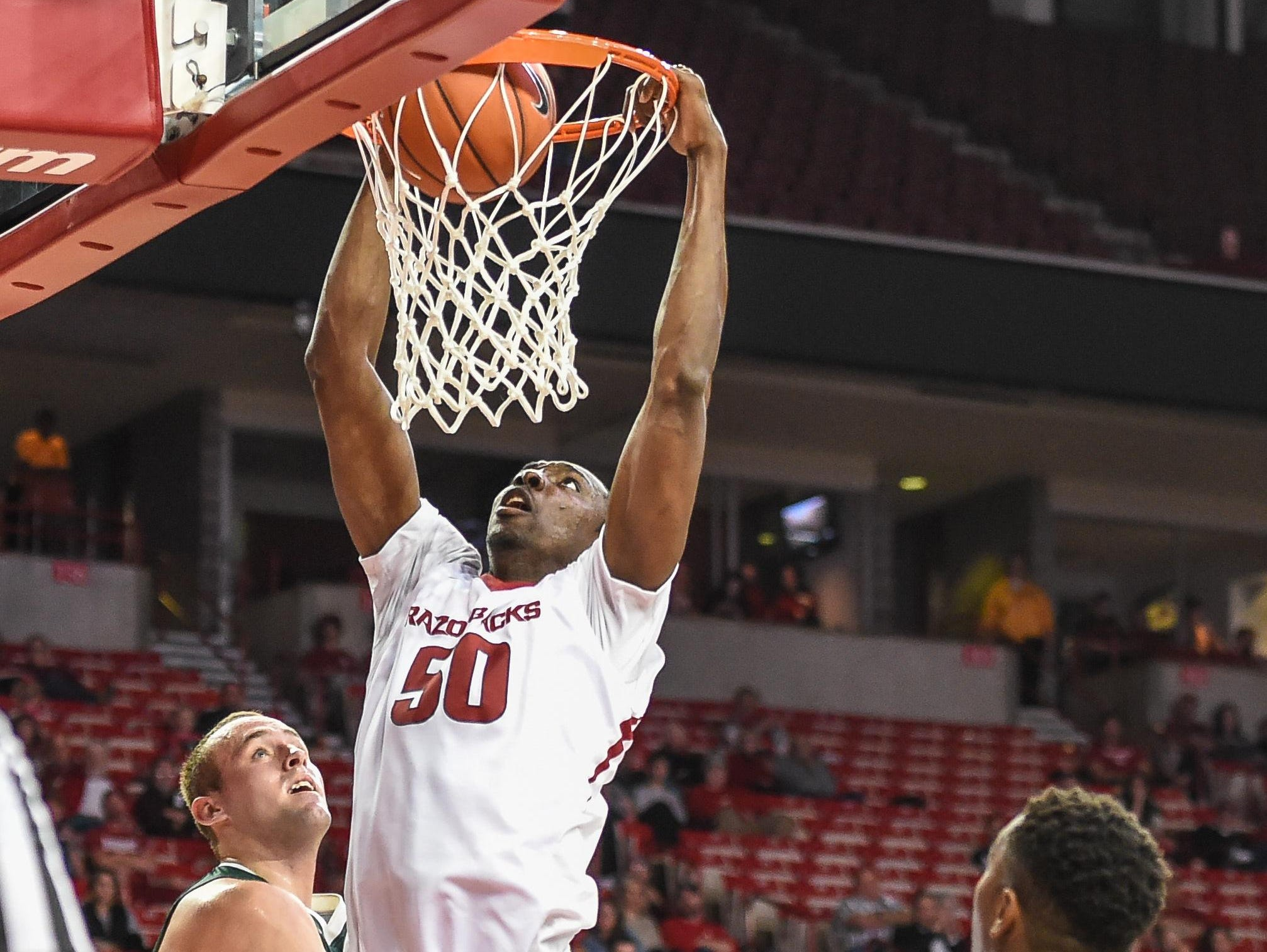 Razorbacks' Willy Kouassi (50) with a dunk during a game between Arkansas and Delta State on Nov. 10.