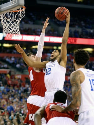 Kentucky's Karl-Anthony Towns makes the shot over Wisconsin's Frank Kaminsky.April 4, 2015