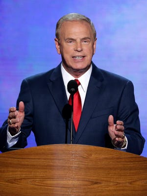 In this Sept. 4, 2012, file photo, former Ohio Gov. Ted Strickland addresses the Democratic National Convention in Charlotte, North Carolina.